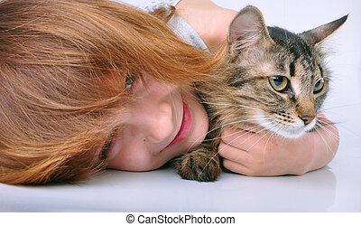 little girl communicating with her pet kitten