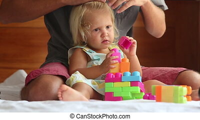 little girl composes constructor by father he cleans her...