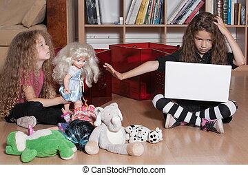 Little girl computing refuse playing