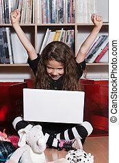 Little girl computing success