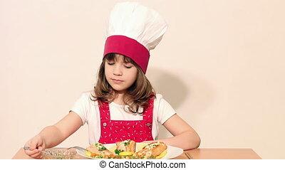 little girl cook eat salmon seafood