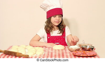 little girl cook kneading dough