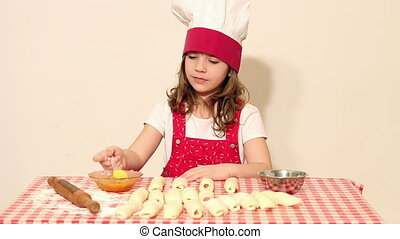 little girl cook make rolls