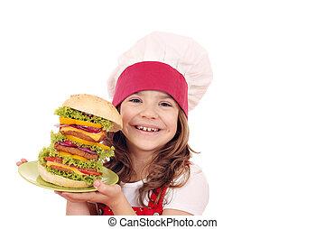 little girl cook with big hamburger