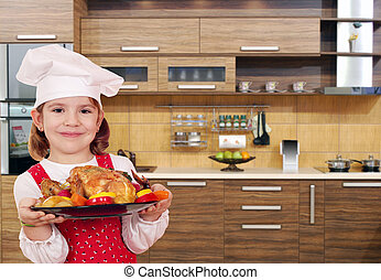little girl cook with chicken in kitchen