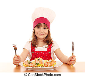 little girl cook with fork and knife
