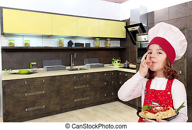 little girl cook with spaghetti in kitchen