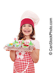 little girl cook with spring flower muffin
