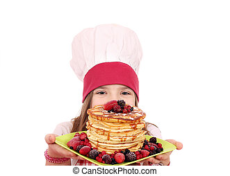 little girl cook with sweet pancakes