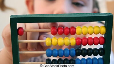 Little girl count on abacus