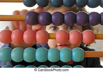 Little girl counting on Abacus