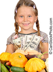 Little girl counts money and vegetables isolated on the white