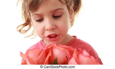 Little girl counts roses in bouquet on white background