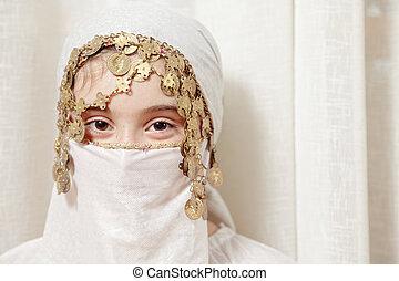 Little girl covering face