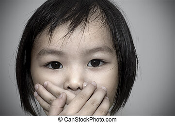 crime witness concept. - little girl covering her mouth,...