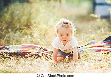 little girl crawling on the lawn