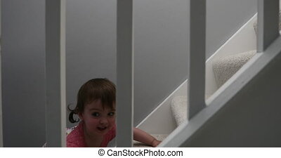 Little Girl Crawling up The Stairs Running Away From her Mam...
