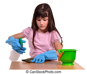 Little girl creaning her desk with cleaning supplies