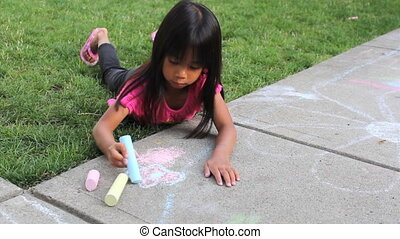 Little Girl Creating Sidewalk Art