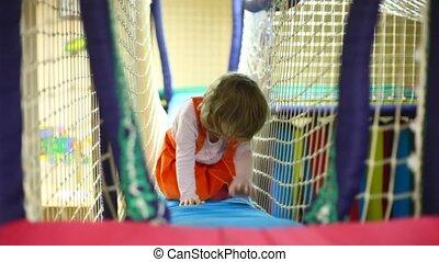 Little girl creep on footbridge