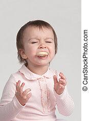Little girl crying eating cookies