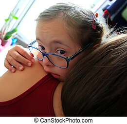 Little girl crying on the mother hands