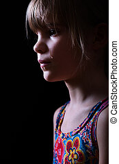 little girl crying in the dark