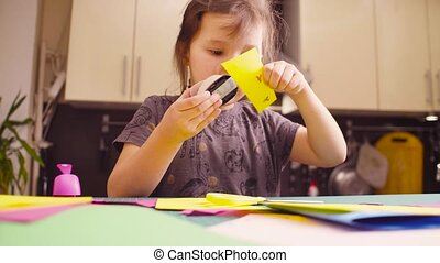 Little girl cutting birds from colored paper - Scrapbooking....
