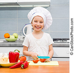 little girl cutting tomatoes