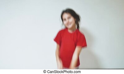 little girl dancing funny. indoor girl a dancing waving her arms. children childhood concept lifestyle
