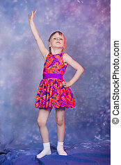 little girl dancing in colourfull costume