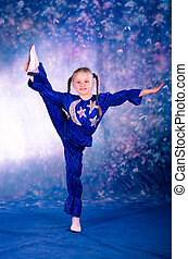 little girl dancing in the blue costume
