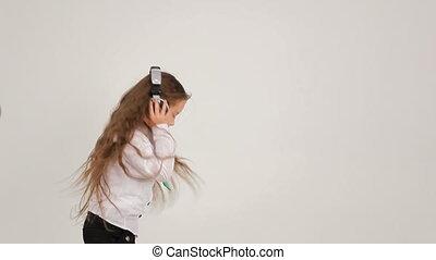 Little girl dancing with headphones