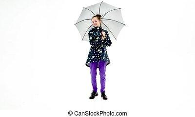 Little girl dancing with umbrella