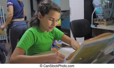 little girl daughter do homework lesson school. slow motion...