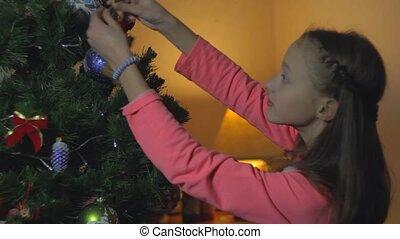 Little Girl Decorate Chrismass Tree