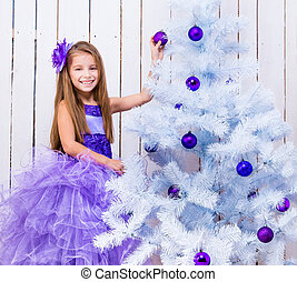 little girl decorated Christmas tree