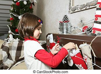 Little Girl Decorating for Christmas