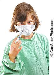 little girl doctor with syringe