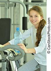 Little girl doing exercises