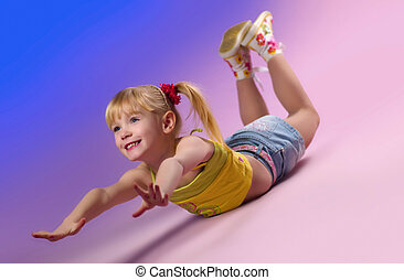 Little girl doing exercises.