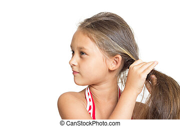 little girl doing hairstyle on a white background