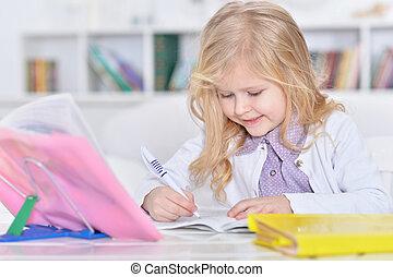 little girl doing homework - Portrait of a cute little girl...