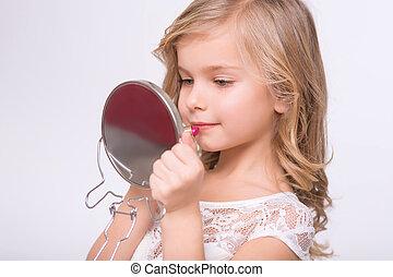 Little girl doing make up