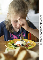 Little girl don't want to eat meal in restaurant.