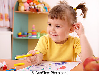 Cute little girl draw with felt-tip pen in preschool