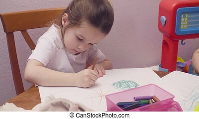 Little girl drawing at a table 4K