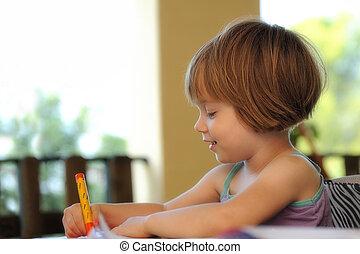 little girl drawing in a summer school