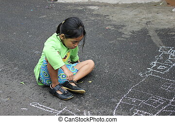 Little Girl Drawing on the Road