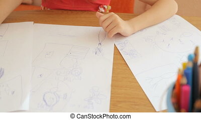 Little girl drawing pictures on paper